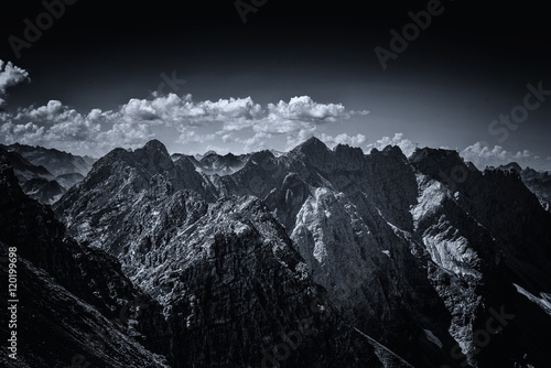 Dark contrasty view on Alps in Allgau Germany Poster