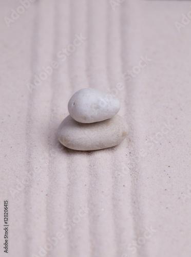 Foto op Plexiglas Stenen in het Zand Two white pebbles on a raked sand