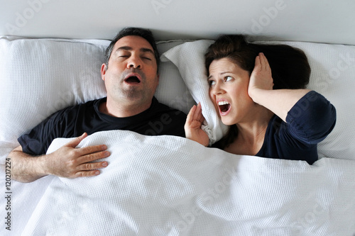 Woman suffers from her partner snoring in bed Canvas Print