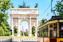 Street View With Old Yellow Tram And Simplon City Gate In Milan