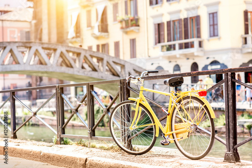 Fotobehang Fiets Bicycle near the water canal in Navigli district in Milan city