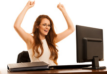 Business Success - Woman Gestures Victori With Her Arms Up In Th