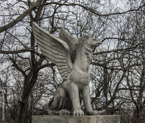 Ancient architecture. Statue of a griffin Poster Mural XXL