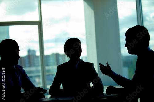 Fotografie, Obraz  Three business people talking in dark office