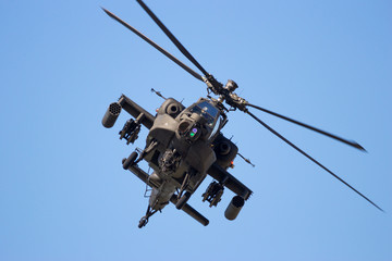 Fototapeta Front view of a flying attack helicopter