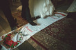 married couple stand on the embroidered towel
