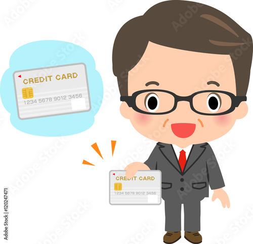 Fotografie, Obraz  クレジットカードを持ったスーツの中年男性