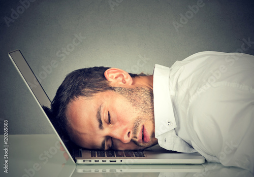 Business man sleeping on his laptop in his office Poster
