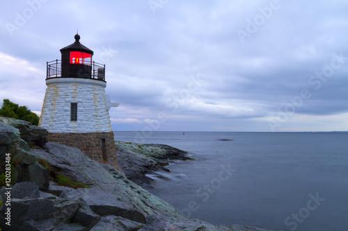 Fotobehang Natuur Park Lighthouse on a rocky shore.