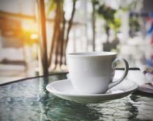 Coffee Cup In Car Showroom, Vi...