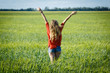 Free happy woman enjoying nature beautiful blonde girl over sky and field outdoor. Freedom concept.