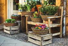 Street Decoration Of Flower Shop With Wooden Boxes And Baskets
