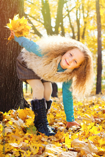 Fotografija  Beautiful Girl with Red Curly Hair in the Autumn Park - Sunny Day - Autumn Fall