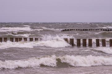 Fototapeta Optyczne powiększenie Wooden breakwater on stormy day - Baltic seascape, Poland