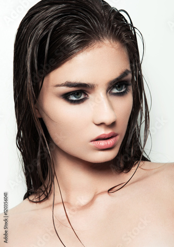 Plakat Beautiful woman with make up and wet hair on white background