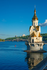 Church on river Dnipro and view of Kyiv, Ukraine