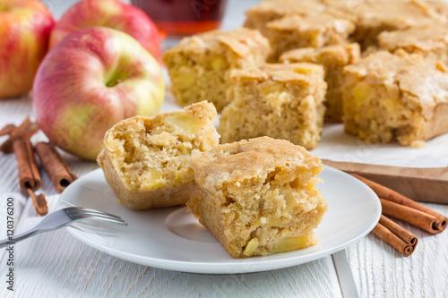 Homemade blondie (blonde) brownies apple cake, square slices on plate Wallpaper Mural