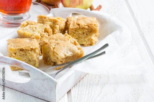Homemade blondie brownies apple cake, square slices, copy space Canvas Print