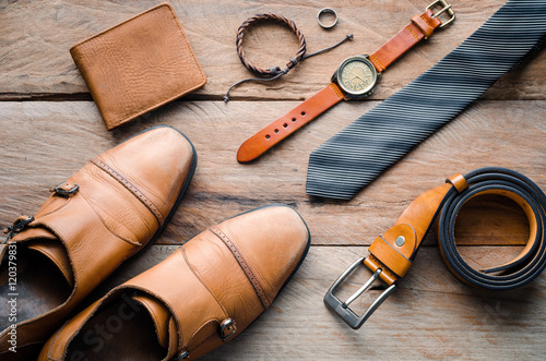 Fototapeta accessories for mens lay on the wooden floor obraz