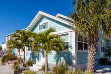 Blue Bungalow And Palm Trees