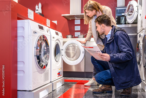 Couple Choosing Washing Machine At Hypermarket Canvas Print