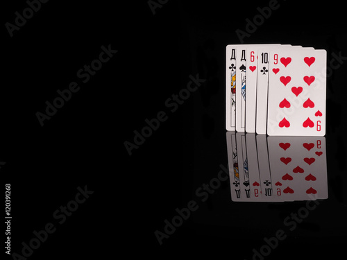 One pair playing cards isolated on black background. плакат