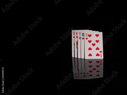 High hand playing cards isolated on black background. плакат