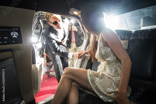 Famous couple getting out of a limousine