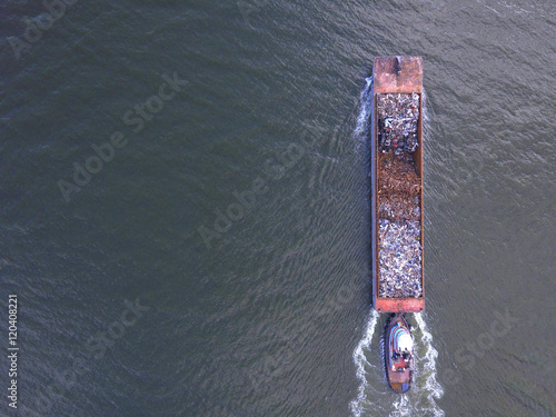 Vászonkép Aerial image of a garbage barge in the river