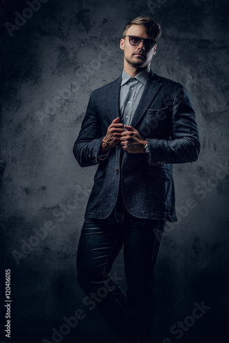 8fcede1610c9 A man in a suit and sunglasses on grey background. - Buy this stock ...