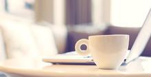 Close Up On White Mug Beside Laptop