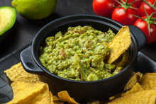 Bowl Of Guacamole With Corn Chips