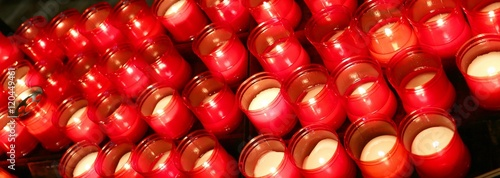 Fotografering  candles lit with flame in the place of prayer