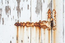 Old Rusted Hinge On A White Door