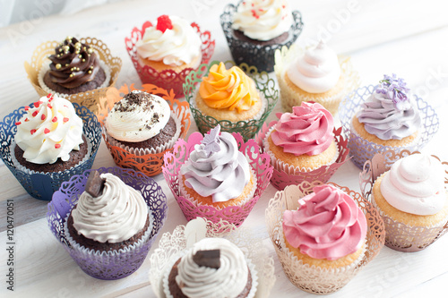 Photo  Many different colored delicious cupcakes
