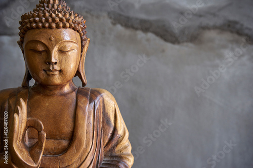 Photo sur Toile Buddha Wooden buddha statue