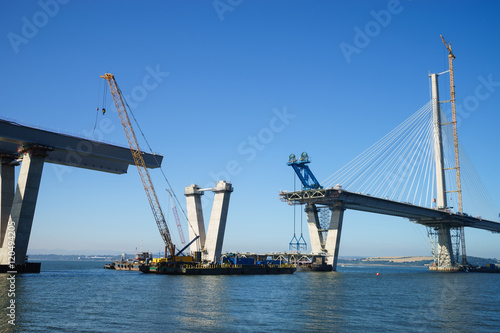 Canvas Prints Bridge The new Queensferry Crossing Bridge under construction, seen from Port Edgar (Edinburgh, Scotland). Showing a mobile crane used for lifting new sections of the deck from barges, and bridge piers.