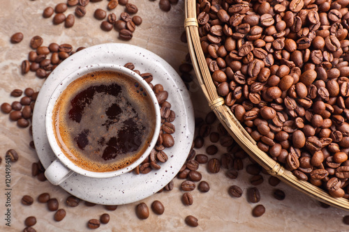 Fototapeta Cup of black coffee and beans
