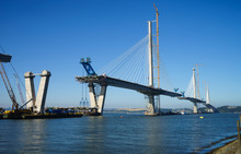 The New Queensferry Crossing Bridge Under Construction, Seen From Port Edgar (Edinburgh, Scotland).  Showing A Mobile Crane Used For Lifting New Sections Of The Deck From Barges, And Bridge Piers.