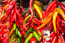 Bunches Of Chilli Peppers Hang...