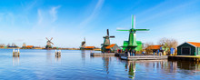 Windmills Panorama In Zaanse Schans, North Holland, Traditional Village, Tourists, Blue Sky