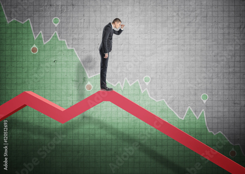 Fotografía  Businessman standing on falling diagram and peering into the future