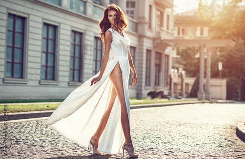 Fashion  photo of beautiful elegan womanl with dark hair wearing