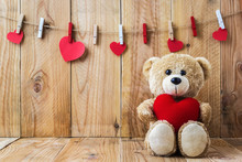 Teddy Bear Holding A Heart-shaped Pillow
