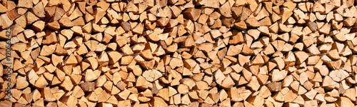 Carta da parati Stack of wood logs, Header wooden abstract background