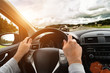 canvas print picture - Man driving his car. Bright light effect