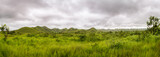 Fototapeta Sawanna - Panorama of african hills in Congo, Mountain of the Moon.