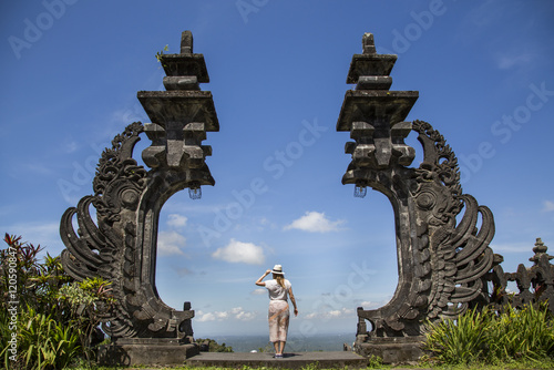 Valokuva  young woman at Besakih temples in Bali, Indonesia