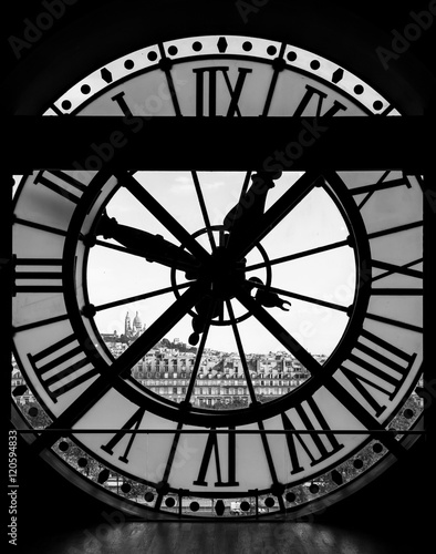 Poster de jardin Paris View through d'orsay museum clock tower of Sacre-Coeur Basilica