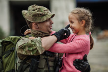 Military Father Hugging His Daughter
